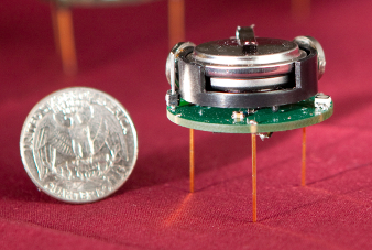 One of the 1024 Robots Michael Rubenstein is developing and building and a quarter.